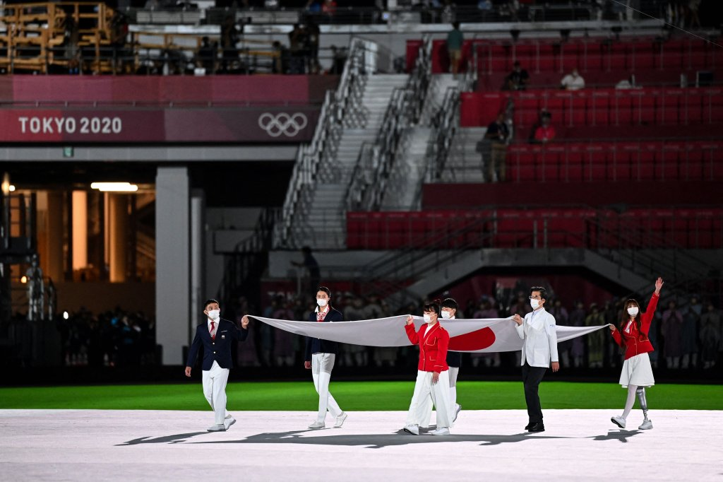 The Olympic flag is carried during the closing ceremony of the Tokyo 2020 Olympic Games, at the Olympic Stadium, in Tokyo, on Aug. 8, 2021.