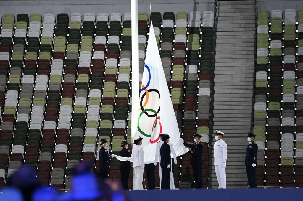 The Olympic flag is taken down during the closing ceremony of the Tokyo 2020 Olympic Games, at the Olympic Stadium, in Tokyo, on Aug. 8, 2021.