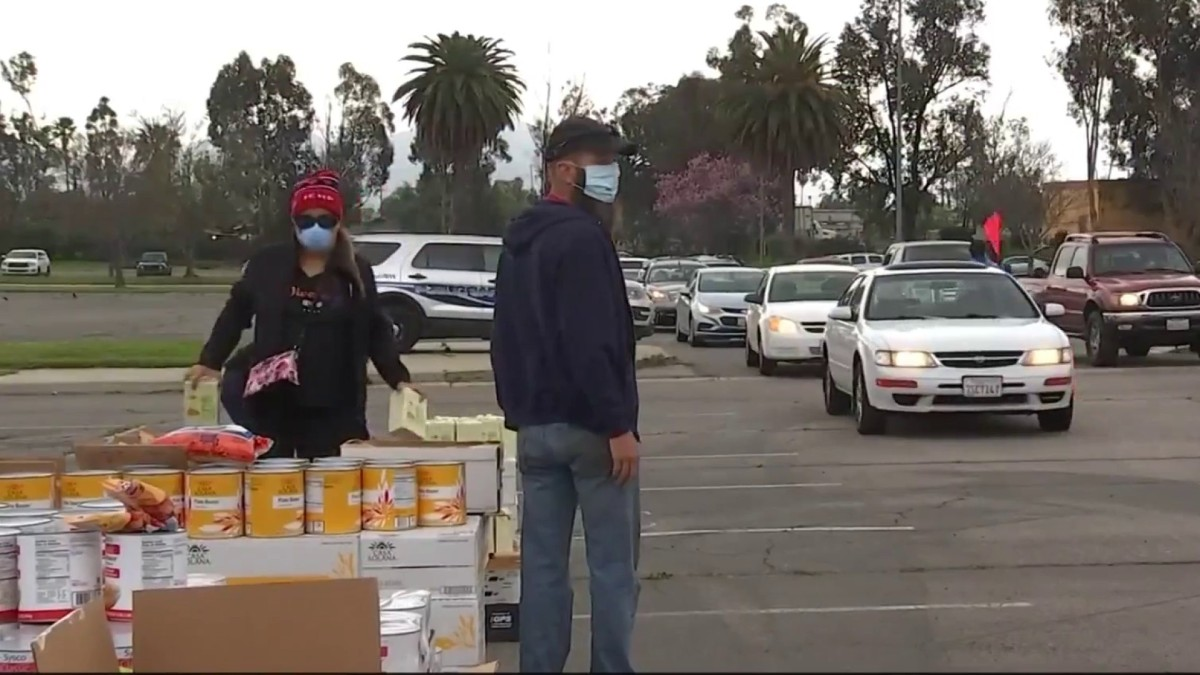 Cars Line Up for Drive-Up Food Distribution in Inland Empire