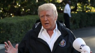 In this file photo, U.S. President Donald Trump speaks to the media before boarding Marine One to depart from the White House, on October 3, 2017 in Washington, D.C.