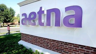 A sign for Aetna Inc., at the company headquarters in Hartford, Conn.
