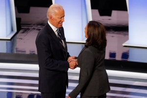 Kamala Harris and Joe Biden shake hands.