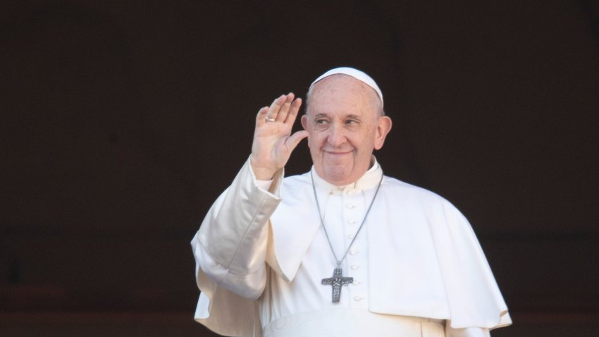 """In this Dec. 25, 2019, file photo, Pope Francis waves to the faithful as he arrives to deliver the Urbi et Orbi (Latin for """"to the city and to the world"""") Christmas day blessing from the main balcony of St. Peter's Basilica at the Vatican."""