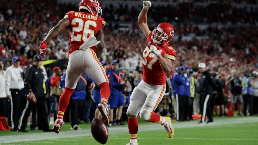 Kansas City Chiefs' Travis Kelce (87) celebrates his touchdown with Kansas City Chiefs' Damien Williams during the second half of the NFL Super Bowl 54 football game against the San Francisco 49ers, Sunday, Feb. 2, 2020, in Miami Gardens, Florida.