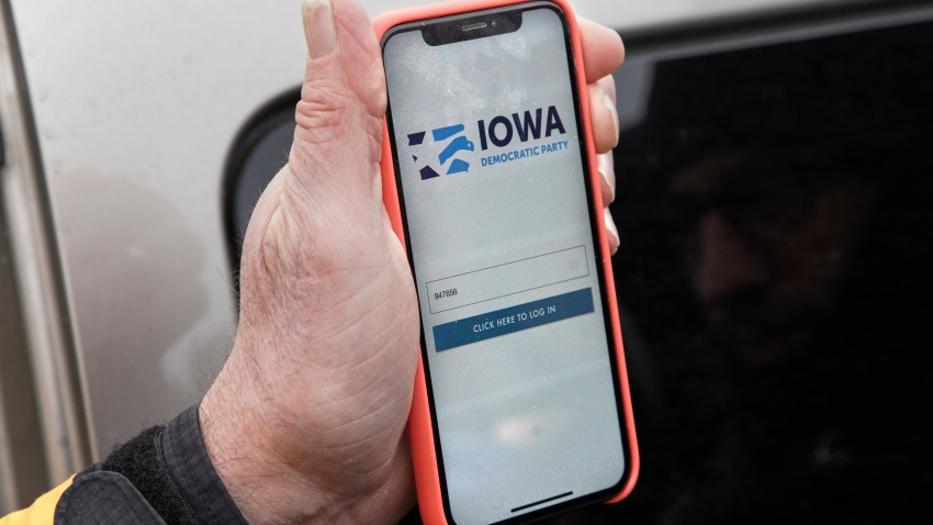Precinct captain Carl Voss of Des Moines displays the Iowa Democratic Party caucus reporting app on his phone outside of the Iowa Democratic Party headquarters in Des Moines, Iowa, Feb. 4, 2020. Technical difficulties with the app delayed expected results the night of the Iowa caucus, forcing the Democratic National Committee to release results intermittently throughout the week.