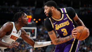 Los Angeles Lakers' Anthony Davis attempts a pass
