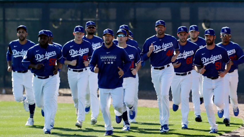 Los Angeles Dodgers pitchers warm up during spring training