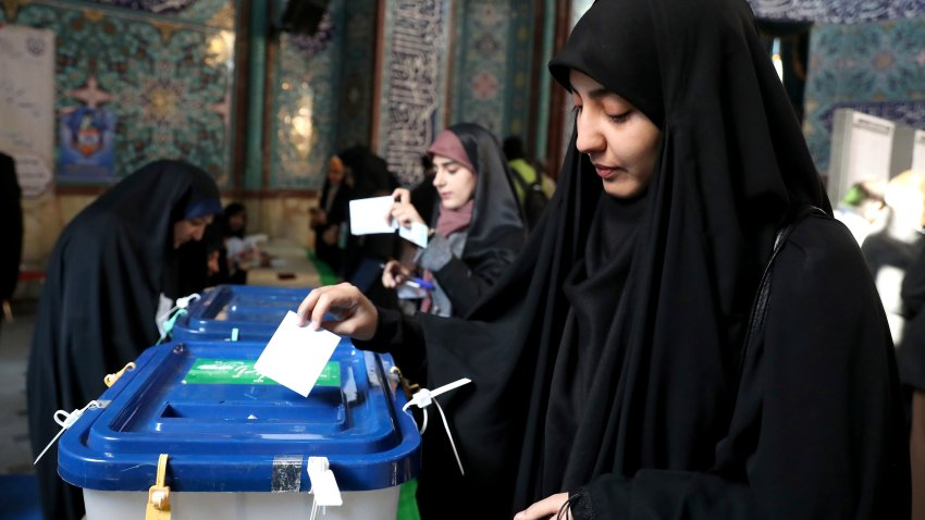 A woman votes in the Iranian election.