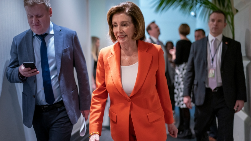 House Speaker Nancy Pelosi, D-Calif., arrives for a meeting with fellow Democrats on Capitol Hill in Washington, Feb. 26, 2020.
