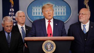 President Donald Trump, center, speaks to members of the media to address the nation about the coronavirus threat in the Brady Press Briefing room of the White House in Washington, Saturday, Feb. 29, 2020. With Trump are from l-r., National Institute for Allergy and Infectious Diseases Director Dr. Anthony Fauci, Vice President Mike Pence and CDC Director Robert Redfield.