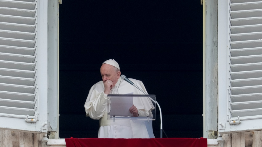 Pope Francis coughs during the Angelus noon prayer