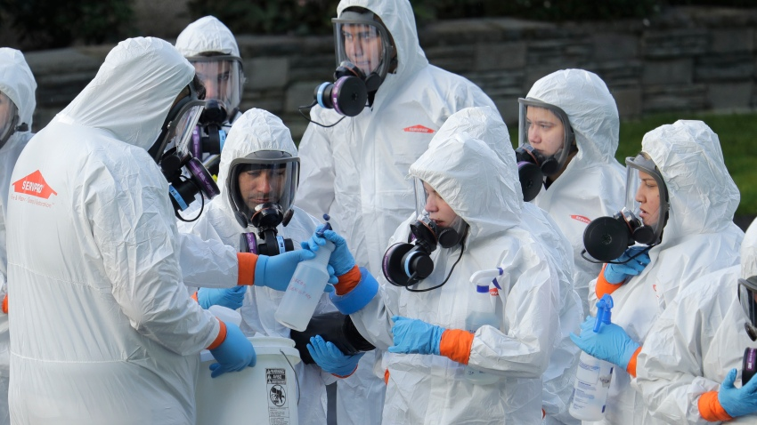 A disaster recovery team prepares to enter a nursing home infected with coronavirus patients