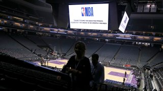 Fans leave the Golden 1 Center after the NBA basketball game between the New Orleans Pelicans and Sacramento Kings was postponed at the last minute in Sacramento, Calif., Wednesday, March 11, 2020.