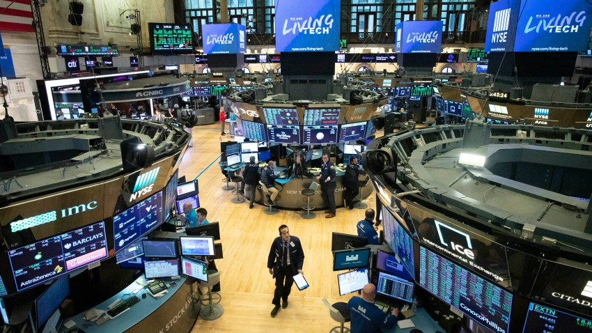 In this Friday, March 13, 2020, file photo, a trader walks on the floor of the New York Stock Exchange during President Donald Trump's televised speech from the White House, in New York.