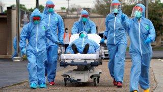 Medical professionals transport a patient