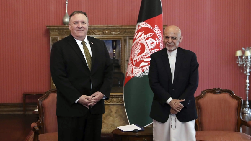 U.S. Secretary of State Mike Pompeo, left, stands with Afghan President Ashraf Ghani, at the Presidential Palace in Kabul, Afghanistan, Monday, March 23, 2020.