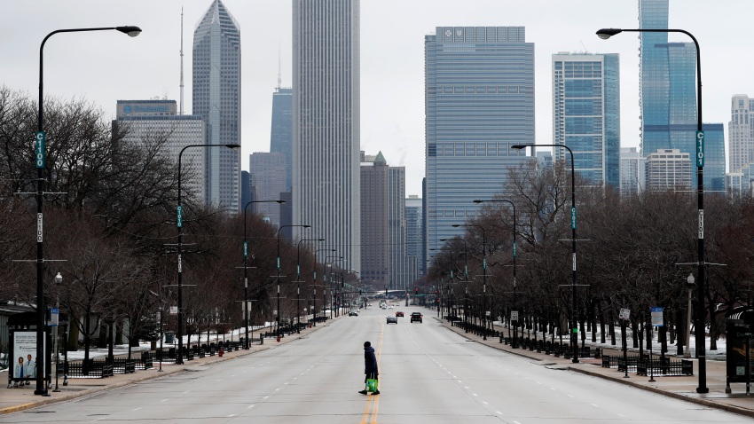 Woman walks across a road in Illinois