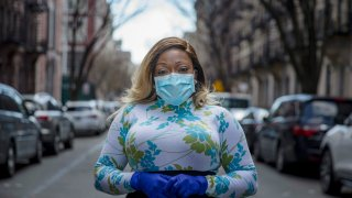 "Tiffany Pinckney poses for a portrait in the Harlem neighborhood of New York on April 1, 2020. After a period of quarantine at home separated from her children, she has recovered from COVID-19. Pinckney became one of the nations first donors of ""convalescent plasma."" Using the blood product is experimental but scientists hope it could help treat the seriously ill and plan to test if it might offer some protection against infection for those at high risk."