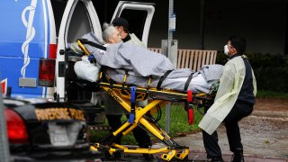 A patient being evacuated from the Magnolia Rehabilitation and Nursing Center in Riverside, Calif.