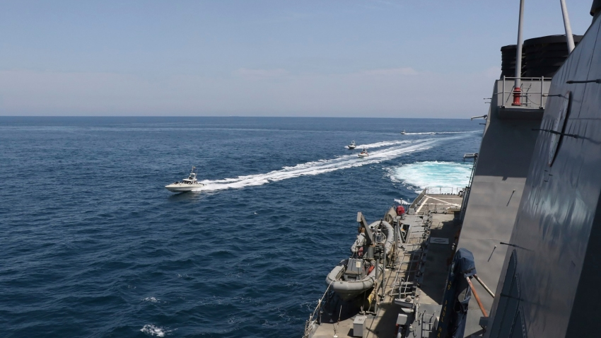 In this Wednesday, April 15, 2020, photo made available by U.S. Navy, Iranian Revolutionary Guard vessels sail close to U.S. military ships in the Persian Gulf near Kuwait.
