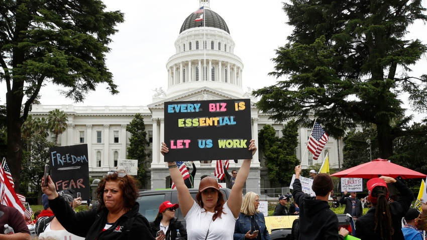 In this Monday, April 20, 2020, file photo, protesters calling for an end of Gov. Gavin Newsom's stay-at-home orders rally at the state Capitol in Sacramento, Calif.