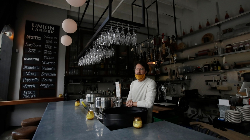 Jay Esopenko, owner of the cheese, wine and charcuterie bar Union Larder, wears a face mask while interviewed during the coronavirus outbreak in San Francisco, Tuesday, May 12, 2020.
