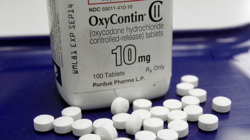 This Feb. 19, 2013, file photo, shows OxyContin pills arranged for a photo at a pharmacy in Montpelier, Vermont.