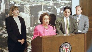 Gini Barrett, Rita Walters and Frank Scherma at a 1996 news conference