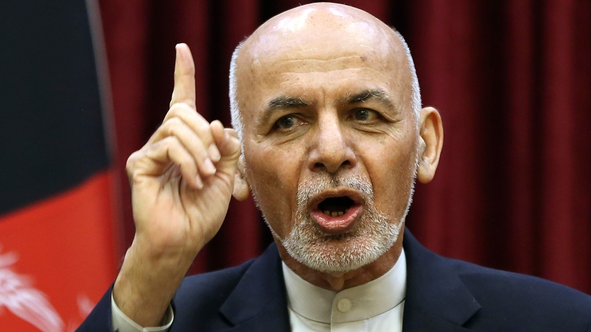 In this March, 1, 2020, file photo, Afghan President Ashraf Ghani speaks during a news conference in presidential palace in Kabul, Afghanistan. Squabbling Afghan presidential rivals threatened to declare themselves president in dueling ceremonies Monday, March 9, 2020, throwing plans for intra-Afghan negotiations into chaos.