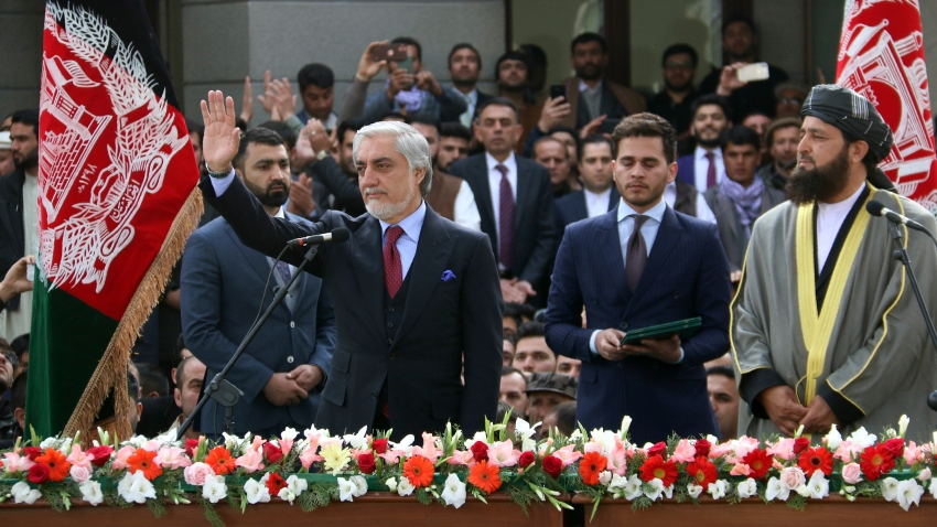 In this Monday, March 9, 2020, photo, Afghanistan's Abdullah Abdullah, front left, greets his supporters after being sworn in as president in Kabul, Afghanistan.