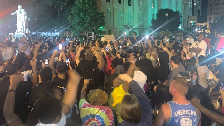 In a photo provided by Jada W., protesters gather Thursday, May 28, 2020, in downtown Louisville, Ky., after Breonna Taylor, a black woman, was fatally shot by police in her home in March. At least seven people were shot during the protest.