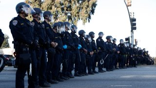 California Highway Patrol officers stand guard during a protest for the killing of George Floyd.