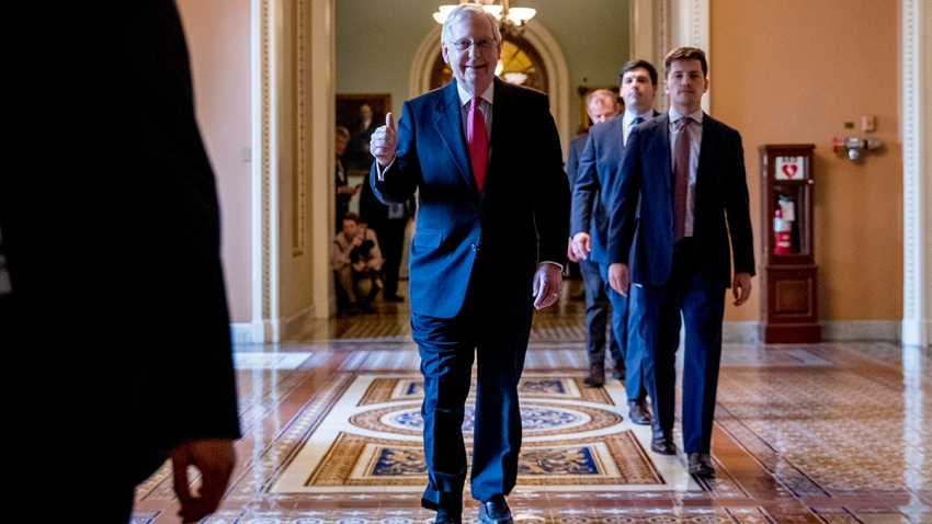 Senate Majority Leader Mitch McConnell of Ky. gives a thumbs up as he leaves the Senate chamber on Capitol Hill in Washington, March 25, 2020, after announcing a deal has been reached on a coronavirus bill.