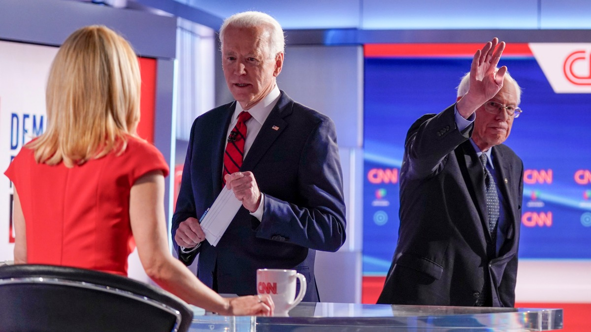 Distance and Silence: Biden, Sanders Clash Without Audience 1