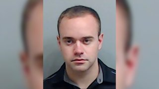 In this booking photo made available Thursday, June 18, 2020 by the Fulton County, Ga., Sheriff's Office, shows Atlanta Police Officer Garrett Rolfe. Rolfe, who fatally shot Rayshard Brooks in the back after the fleeing man pointed a stun gun in his direction, was charged with felony murder and 10 other charges. Rolfe was fired after the shooting.