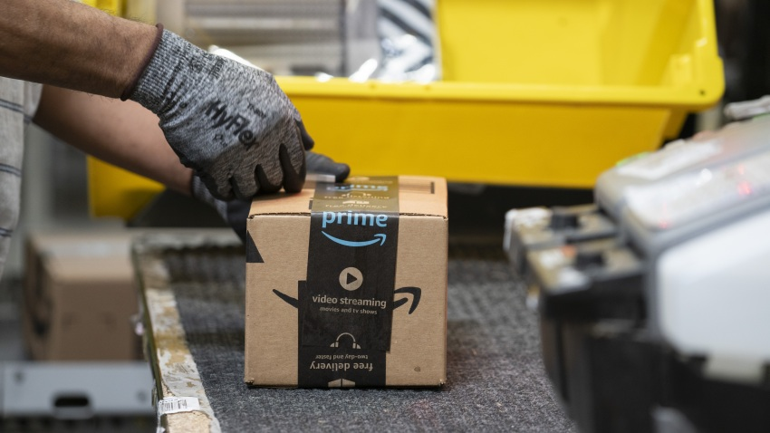 An employees places a label on a box at the Amazon.com Inc. fulfillment center in Baltimore, Maryland