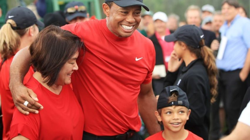 Tiger Woods of the United States celebrates with his mom and son Charlie Axel