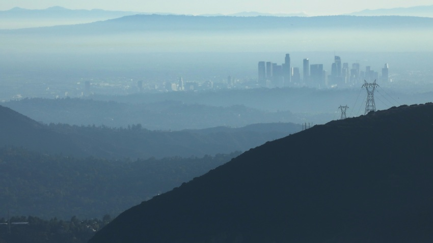 """In this Nov. 5, 2019, file photo, the buildings of downtown Los Angeles are partially obscured in the afternoon as seen from near Pasadena, California. The air quality for metropolitan Los Angeles was predicted to be """"unhealthy for sensitive groups"""" by the South Coast Air Quality Management District."""