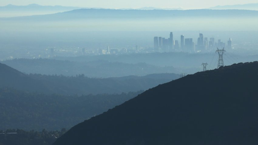 "In this Nov. 5, 2019, file photo, the buildings of downtown Los Angeles are partially obscured in the afternoon as seen from near Pasadena, California. The air quality for metropolitan Los Angeles was predicted to be ""unhealthy for sensitive groups"" by the South Coast Air Quality Management District."