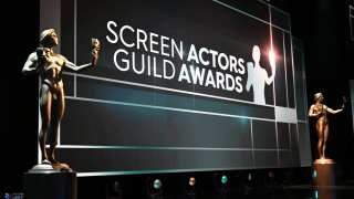In this Jan. 19, 2020, file photo, SAG award statues are seen on stage as final preparations are made at the Shrine Auditorium for the 26th annual Screen Actors Guild Awards in Los Angeles. The SAG Awards will be broadcast live on TNT and TBS.