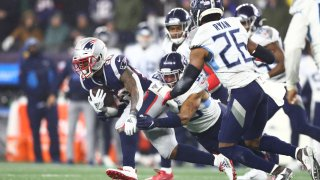 James White of the New England Patriots carries the ball against the Tennessee Titans in the AFC Wild Card Playoff game at Gillette Stadium on Jan. 4, 2020, in Foxborough, Massachusetts. The Titans won 20-13.