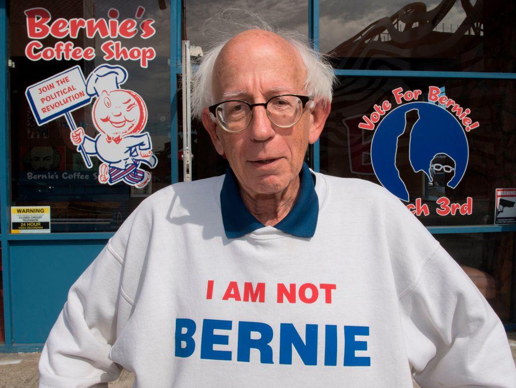 "Bernie Sanders lookalike Jeff Jones wears his ""I am not Bernie"" sweater outside the candidate's campaign headquarters in Los Angeles, California on February 28, 2020"