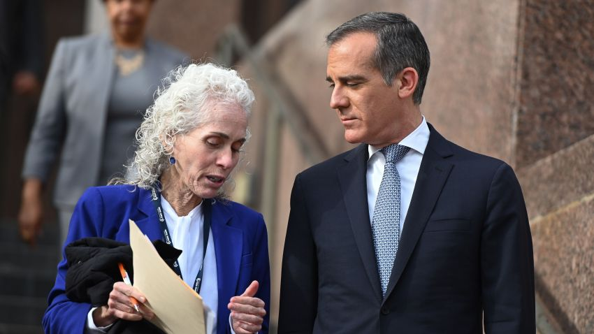 Los Angeles County Public Health director Barbara Ferrer (L) and Los Angeles Mayor Eric Garcetti speak as they arrive for a press conference on March 4, 2020, in Los Angeles.