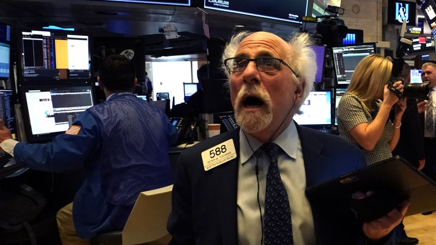 Peter Tuchman, floor trader, reacts as he works on the floor during the opening bell on the New York Stock Exchange on March 9, 2020 in New York.