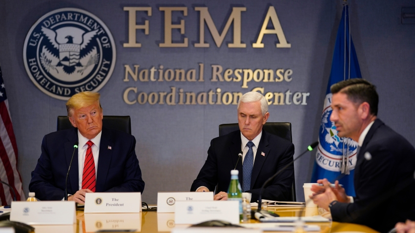 President Donald Trump, left, and Vice President Mike Pence listen as Acting Secretary of Homeland Security Chad Wolf speaks during a teleconference with governors at the Federal Emergency Management Agency headquarters on March 19, 2020, in Washington, DC.