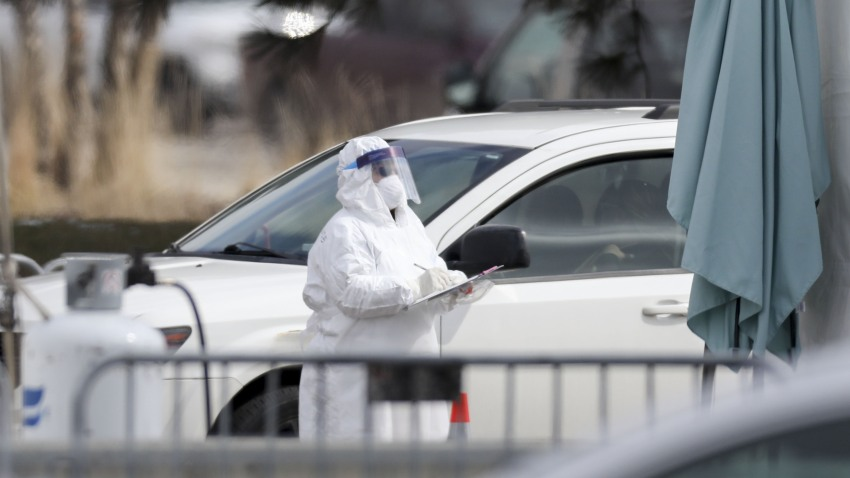 A medical worker holds a clipboard at a drive-thru Covid-19 testing location in the parking lot outside a Walmart store in Northlake, Illinois, U.S., on Monday, March 23, 2020. Illinois Governor J.B. Pritzker issued a shelter-in-place order to take effect Saturday at 5 p.m., following California and New York as more states restrict the movement of their residents to combat the new coronavirus.