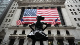 In this March 29, 2020, file photo, the New York Stock Exchange building is seen in the Financial District of New York City.