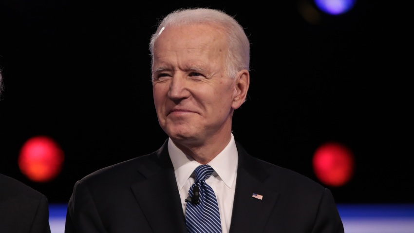 In this Feb. 25, 2020, file photo, Democratic presidential candidate former Vice President Joe Biden arrives on stage for the Democratic presidential primary debate at the Charleston Gaillard Center in Charleston, South Carolina.