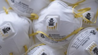 In this April 6, 2020, file photo, 3M Co. 8210V N95 particulate respirators are photographed in Hong Kong, China.