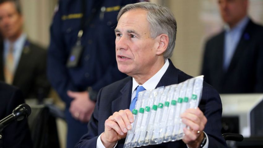 Texas Governor Greg Abbott displays COVID-19 test collection vials as he addresses the media during a press conference held at Arlington Emergency Management on March 18, 2020 in Arlington, Texas.